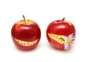 Apples with smiling mouth isolated on white background